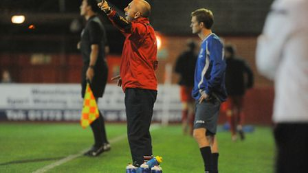 Lynn's manager for the night Neil Fryatt, red, with his 'assistant', reserve team boss Jonathan Hawe
