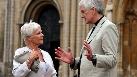 Dame Judi Dench with the Dean of Norwich, the Very Rev Graham Smith, during her visit to Norwich. P