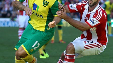 Norwich City midfielder Anthony Pilkington has labelled speculation on Chris Hughton's future as 'cr