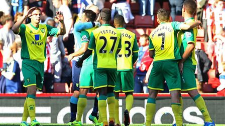 Norwich City's players celebrate after a 1-0 Premier League away win at Stoke on Sunday. Picture by