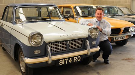 Auctioneer Tristram Belemore-Smith, with from left, the 1961 Triumph Herald, the 1978 Triumph Dolomi
