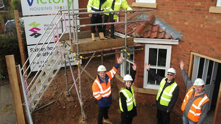 Wellington Construction managing director Paul Ollington (top left) and Victory Housing Trust chief