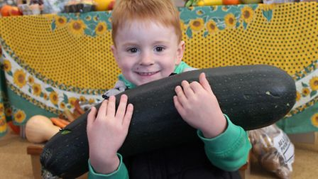 Three-year-old Ladybird Pre-School Nursery pupil George with his donation for Cromer Food Bank.Photo