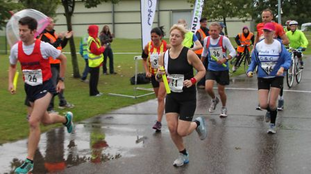 Runners set out on the first stage of the Birketts Round Norfolk Relay.