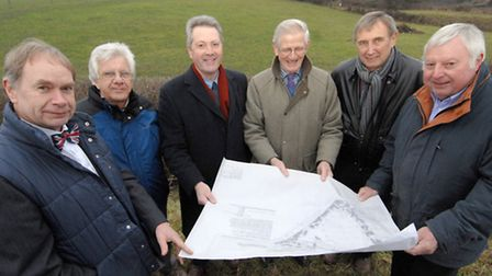 Councillors looking at the Thornage Road car park plans with Graham Chapman. From left, Mike Baker,
