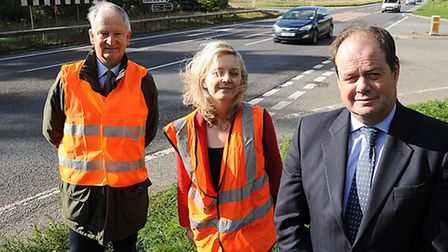 MPs Henry Bellingham and Elizabeth Truss with transport minister Stephen Hammond at the Castle Acre