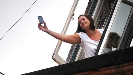Manager of The White Horse pub in Overstrand, Lucie Gillett, trying to get a signal on her phone fro