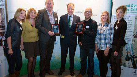 Staff from the Green Dragon, which was crowned South Norfolk's community pub of the year, with Georg