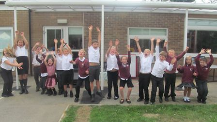 Children at Gillingham Primary School celebrate the latest Ofsted report.
