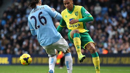 Josh Murphy of Norwich and Martin Demichelis of Man City in action during the Barclays Premier League match at the Etihad...