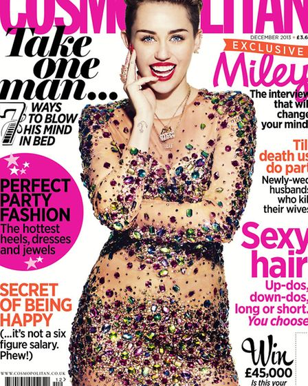 The front cover of December's edition of Cosmopolitan, which features a naked photoshoot of former T