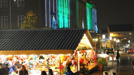 The Christmas lights outside Norwich City Hall glisten on the wet pavements as Christmas day 2012 ap