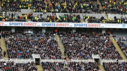 The traveling Norwich fans high up in the stands before the Barclays Premier League match at St James' Park Stadium...