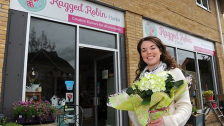 Wymondham florist Anna Pickwell outside her re-branded shop the Ragged Robin, named after a competition run in local...