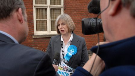 Out on the campaign trail with Theresa May - conservative prospective parliamentary candidate Chloe Smith leafleting in...