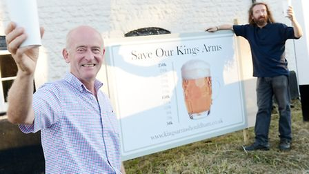 Residents of Shouldham are in the process of buying the King's Arms Pub - From left, John McGorty and Jim Ross with the...