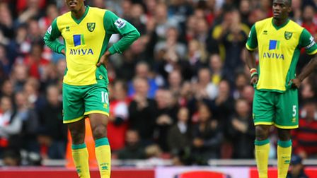 Norwich City duo Leroy Fer and Sebastien Bassong sum up the mood after Arsenal's fourth in a 4-1 Premier League defeat at...