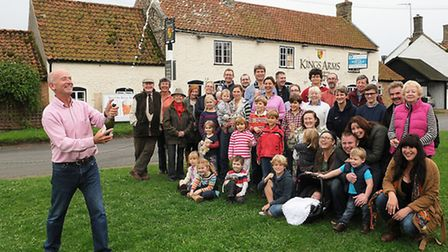 Villagers and John McGourty, chairman of the Save Our King's Arms (SOKA) campaign, outside the King's Arms at Shouldham.