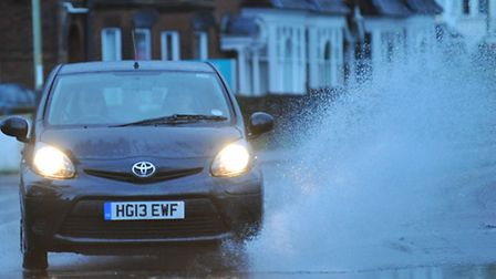 Early morning traffic splashes through Norwich as Storm St Jude hits Norwich. PHOTO BY SIMON FINLAY