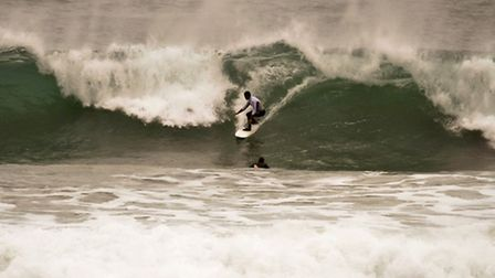 Surfers make the most of huge waves in Newquay, Cornwall, as England and Wales face a battering toni