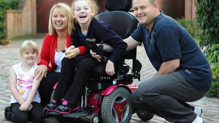 Amber Atkins, 11, with her family, mum Lyn, dad Jason, and sister Millie, 5. Amber has been awarded an £8.1 million...