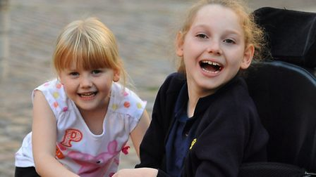 Amber Atkins, 11, with her sister Millie, 5. Amber has been awarded an �8.1 million settlement after