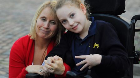 Amber Atkins, 11, with her mum Lyn. Amber has been awarded an �8.1 million settlement after being le