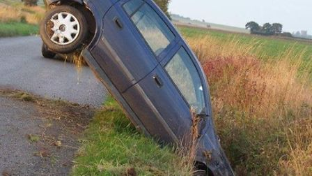 A blue Vauxhall Astra ended up in a ditch in Loddon this morning