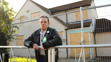 Former councillor, Richard Edwards, with the boarded up city council neighbourhood office at Hansard Close in Mile Cross.