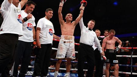 Disappointment for Ryan Walsh (right) as Lee Selby celebrates winning his British and Commonwealth f