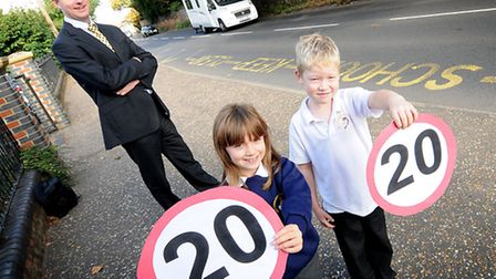 Holt Primary School pupils happy at the new 20mph speed limit near the school. Pupils Sophie Marlow