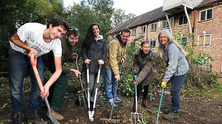Alysham's Mill Row residents and friends help to clear up the green at Aylsham Mill. Left to right,
