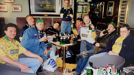 Steve Downes (third from right) with friends on the way back from Norwich City's trip to Internation