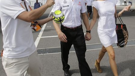 McLaren's Jenson Button and his girlfriend Jessica Michibata are approached by an autograph hunter a