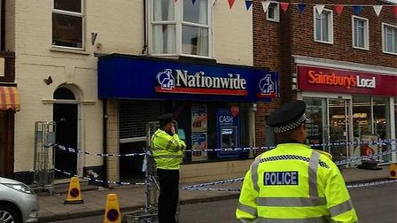 The police cordon outside the Nationwide and Sainsbury's in Sheringham High Street.
