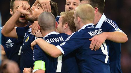 Robert Snodgrass celebrates the birth of his baby daughter after scoring for Scotland. Picture: PA