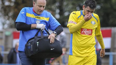 Rob Duffy, right, walks off after breaking his nose on Saturday. Picture: Matthew Usher.