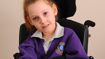 Nine year old Amber Atkins who is overjoyed with her smart new pink wheelchair that she has received
