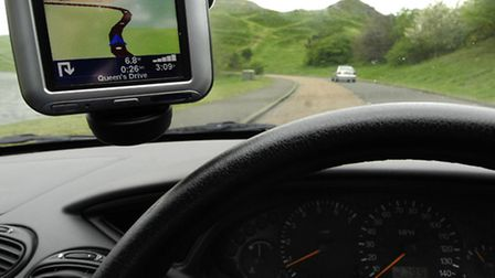 File photo dated 25/04/07 of a Tom Tom satellite navigation system attached to a car windscreen. Alm
