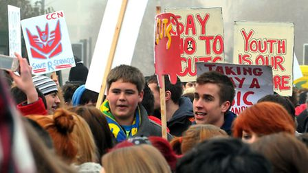 Student march though Norwich in 2010 to protest against cuts on their way to deliver a petition at C