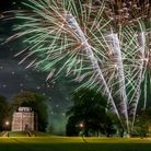 Fawkes in the Walks 2012 in King's Lynn - The Red Mount chapel has a background of fireworks, as the