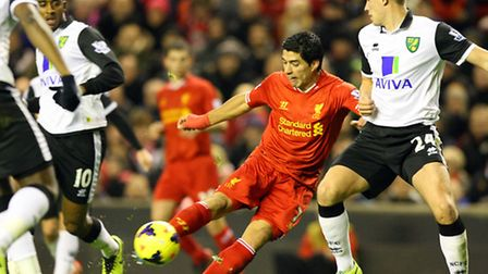Luis Suárez of Liverpool scores his sides 3rd goal during his side's 5-1 Premier League win at Norwi