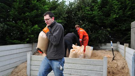 Preparations for possible flooding in the Yarmouth area.People filling sandbags.