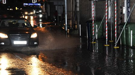 South Brink Wisbech, Water flooding onto road from river.
