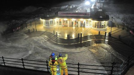 Flood water breaches the pier forecourt at Cromer. Photo: Duncan Abel.