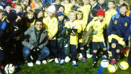 Dom Dwyer meets some of King's Lynn Community Football's latest crop on a visit to England around Ch