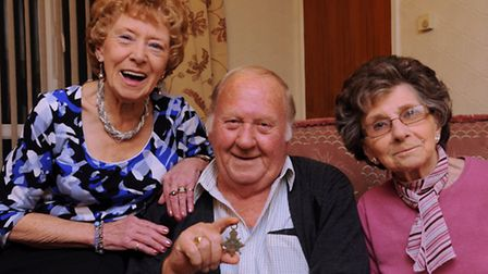 Ann Daynes, left, David Forder, and Mary Brooks are reunited with their grandfather's war medal, fou