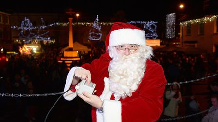 A large crowd turned out to see Father Christmas turn on the Christmas Lights in Fakenham town centr