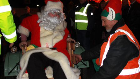 Father Christmas arriving by vintage motorcycle for Aylsham's festive lights switch-on. Photo: Karen