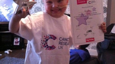 Six-year-old Brogan Didwell with her Cancer Research UK Little Star Award.